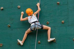 girl indoor rock climbing